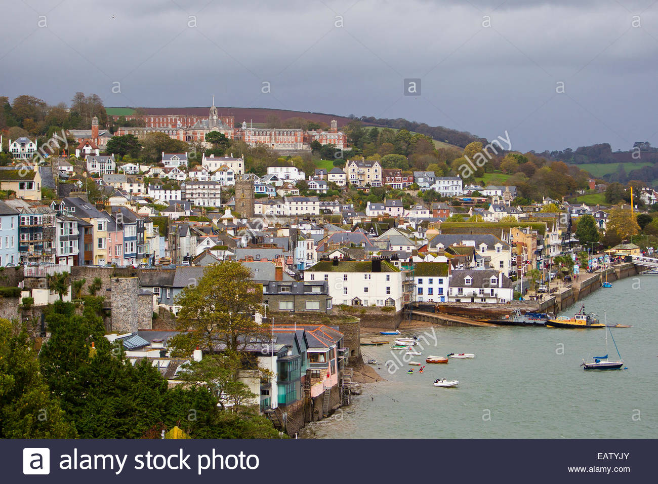 The town of Dartmouth and Britannia Royal Navy College atop the hill. - Stock Image