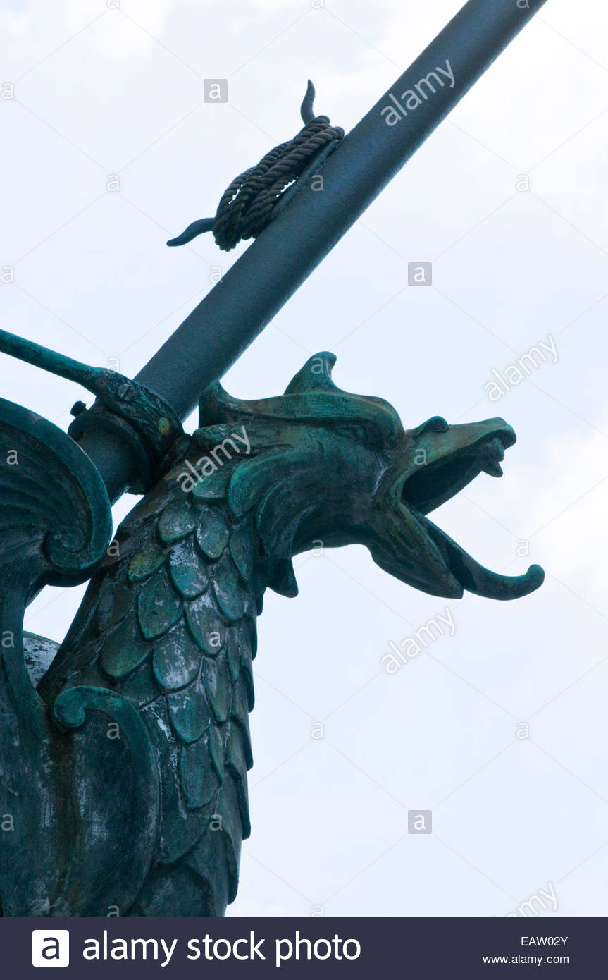 A dragon flag holder with a green patina in Baltimore, Maryland. - Stock Image
