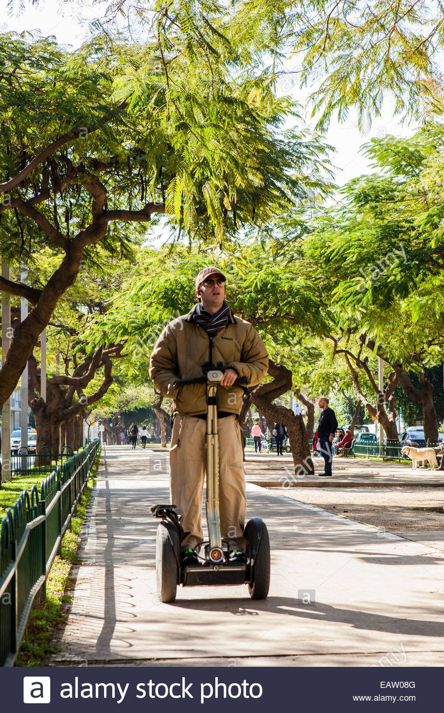 A man rides segway on Rothschild Boulevard on a Friday. - Stock Image