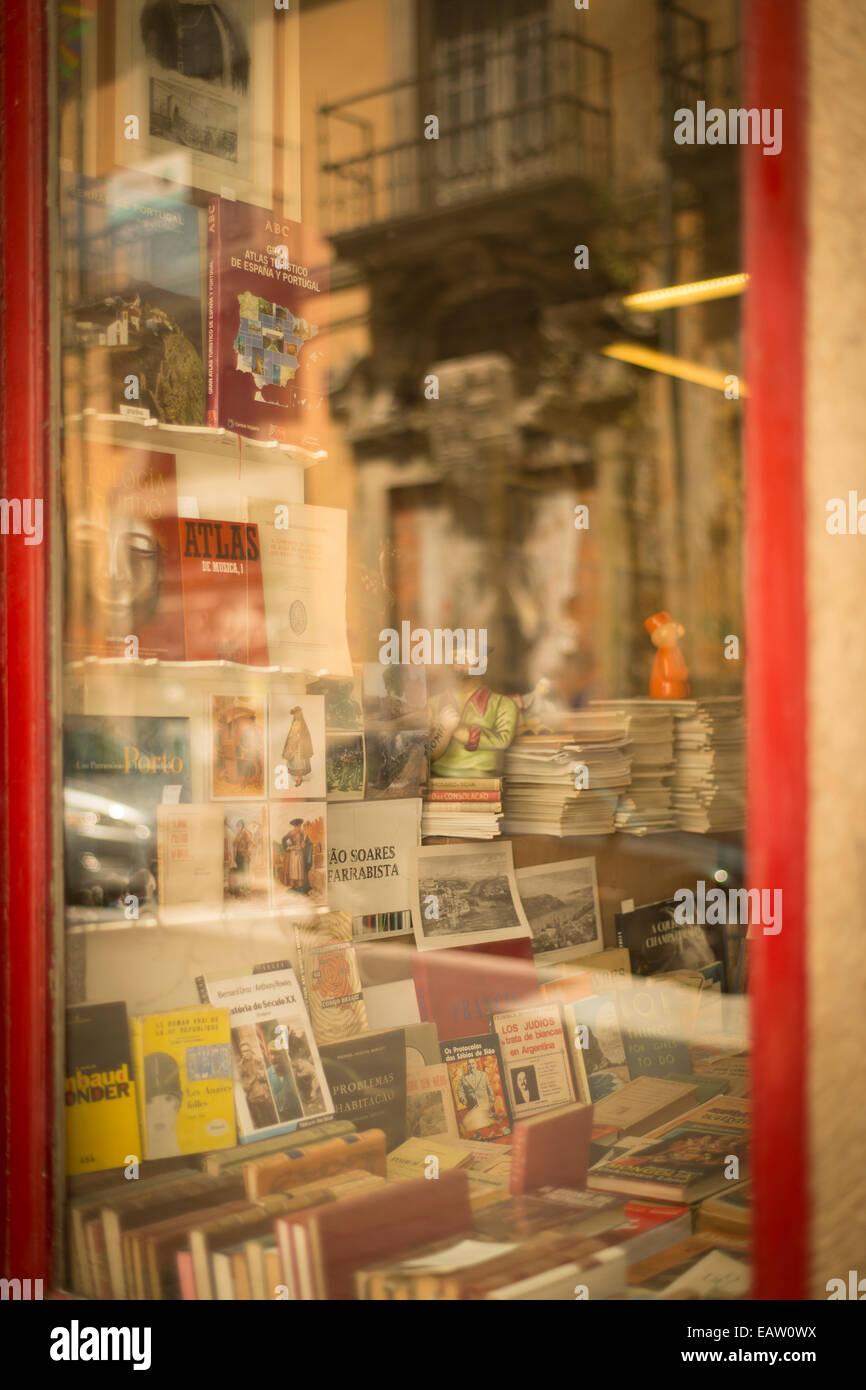 A bookstore window in Porto Portugal offers classics and rare books in the old city. - Stock Image