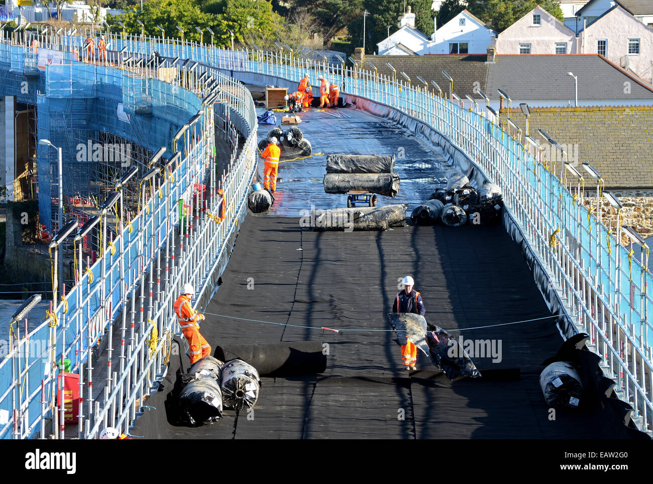 Workmen on the rail track during repairs to Hayle viaduct in Cornwall, UK - Stock Image