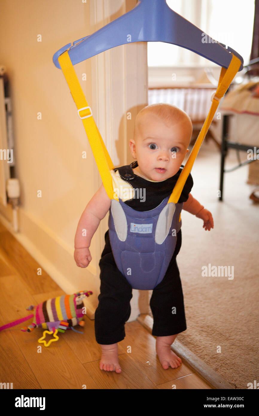 Baby In A Door Bouncer Stock Photo 75539196 Alamy