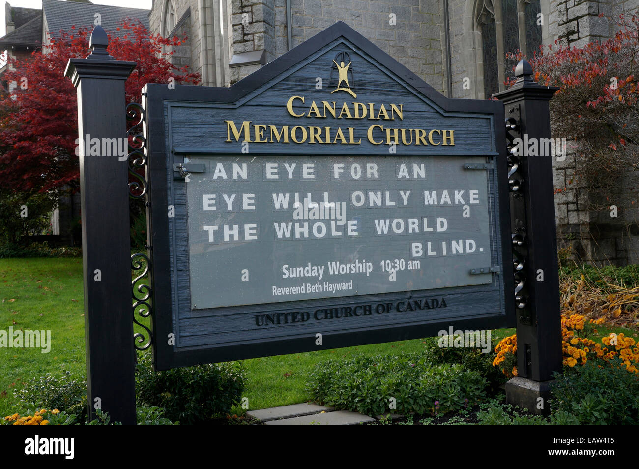 An eye for an eye saying on a sign outside Canadian Memorial United Church, Vancouver, BC, Canada - Stock Image