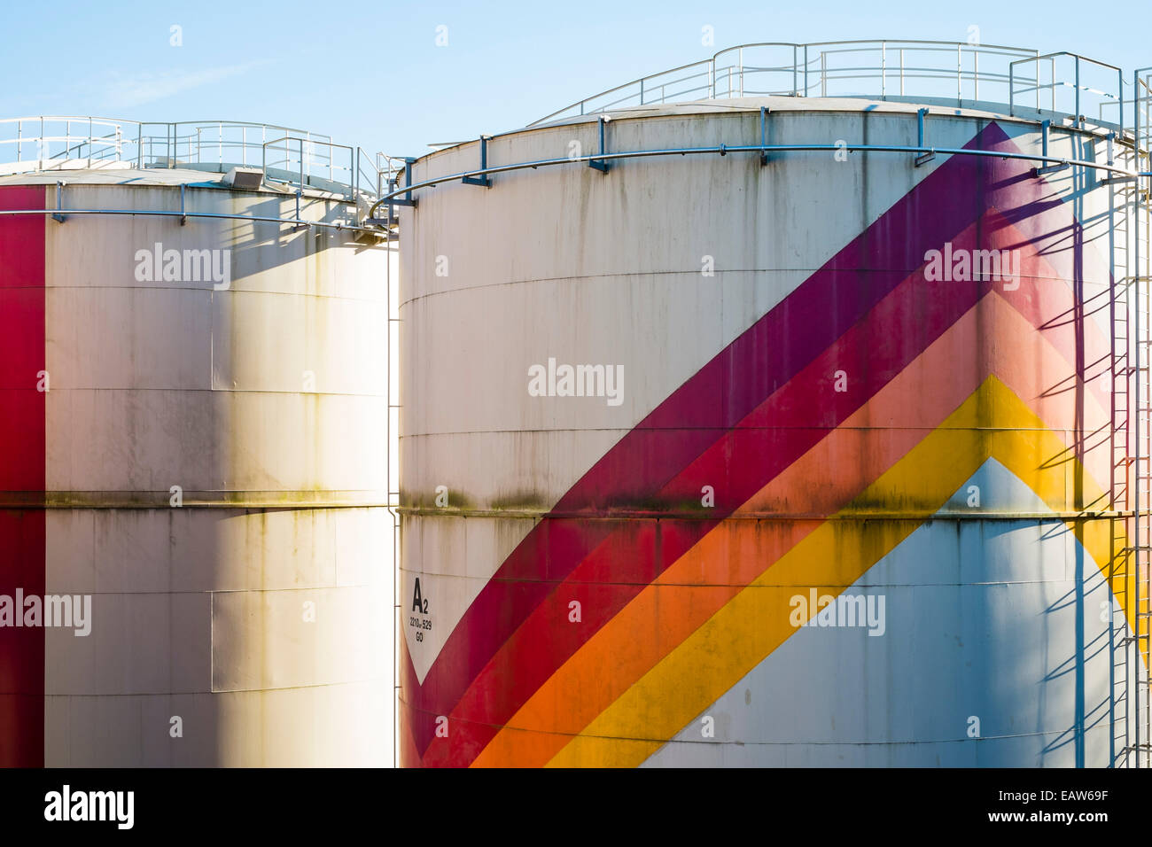 Colorful petrochemical storage tanks used for storing liquid gasses, La Souterraine, La Creuse Department, Limousin, - Stock Image