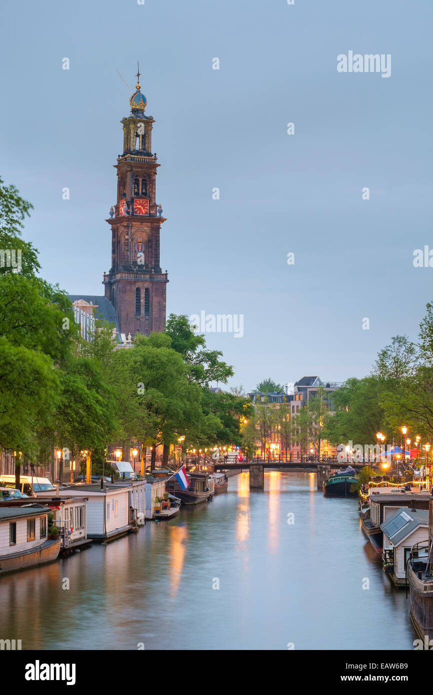 Prinsengracht canal at dusk with Westerkerk in distance, Amsterdam, North Holland, Netherlands Stock Photo