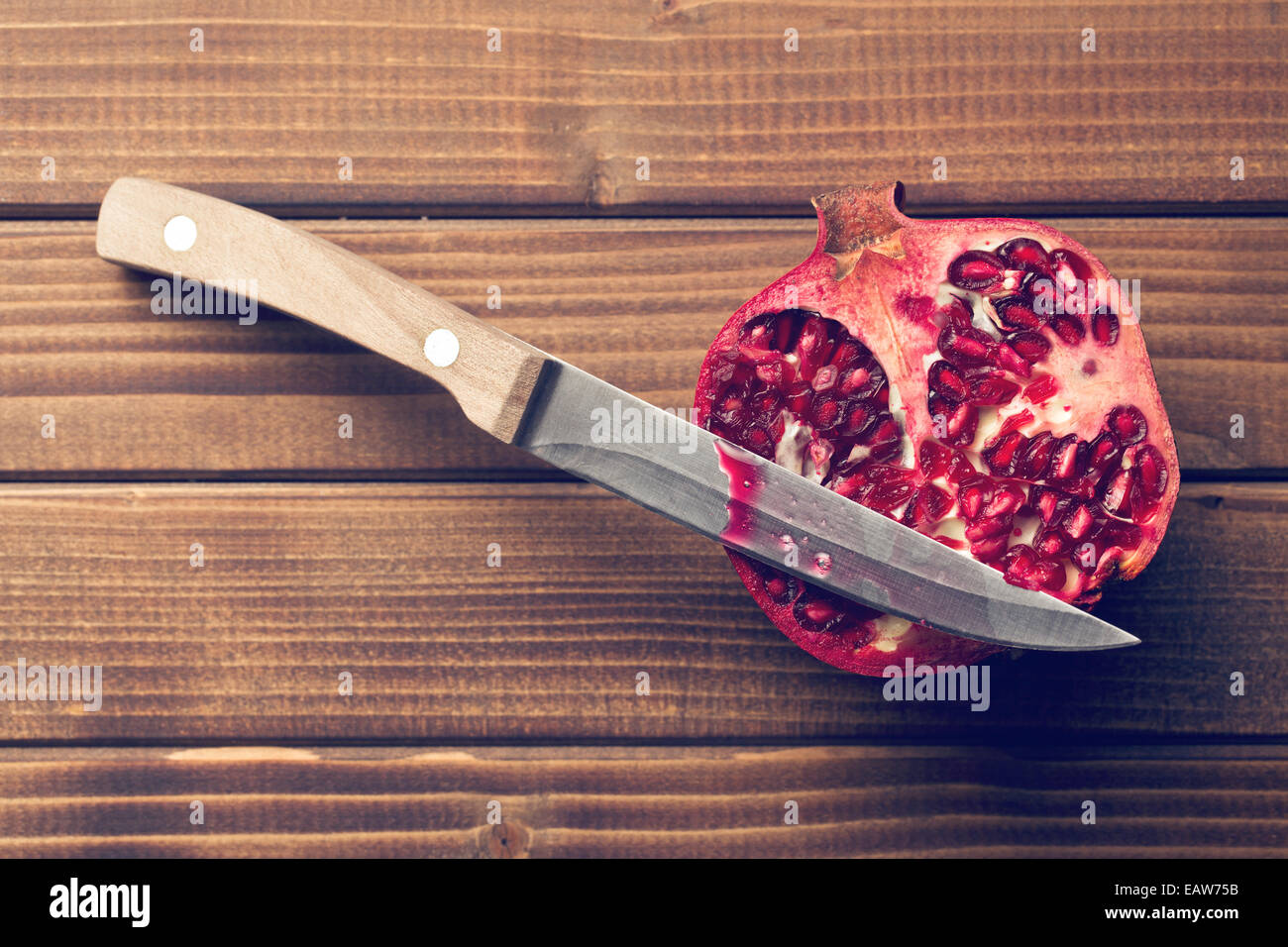 red pomegranate on wooden table Stock Photo