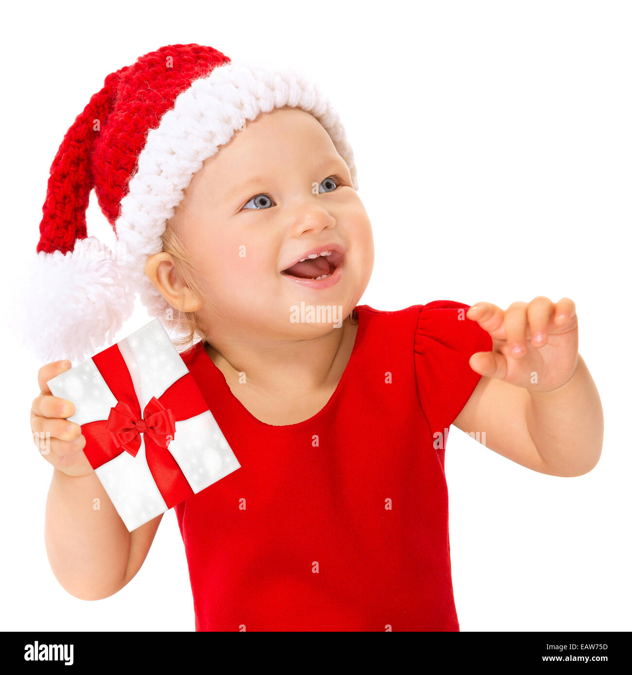 2c290ce34a5 Closeup portrait of happy smiling child with Christmas gift isolated on  white background