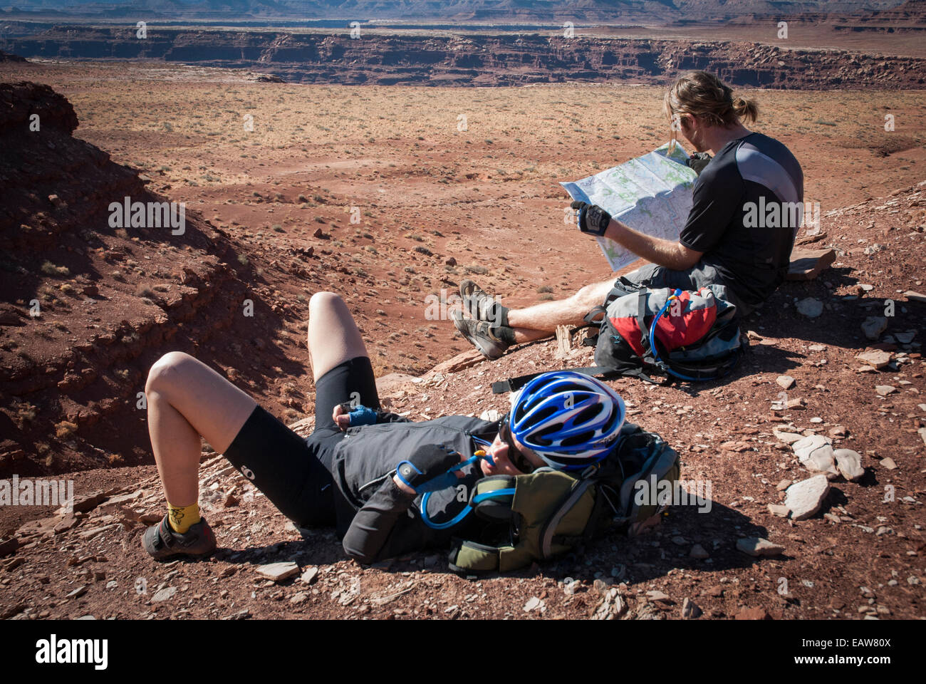 Mountain bikers consult their topo maps while touring the White Rim