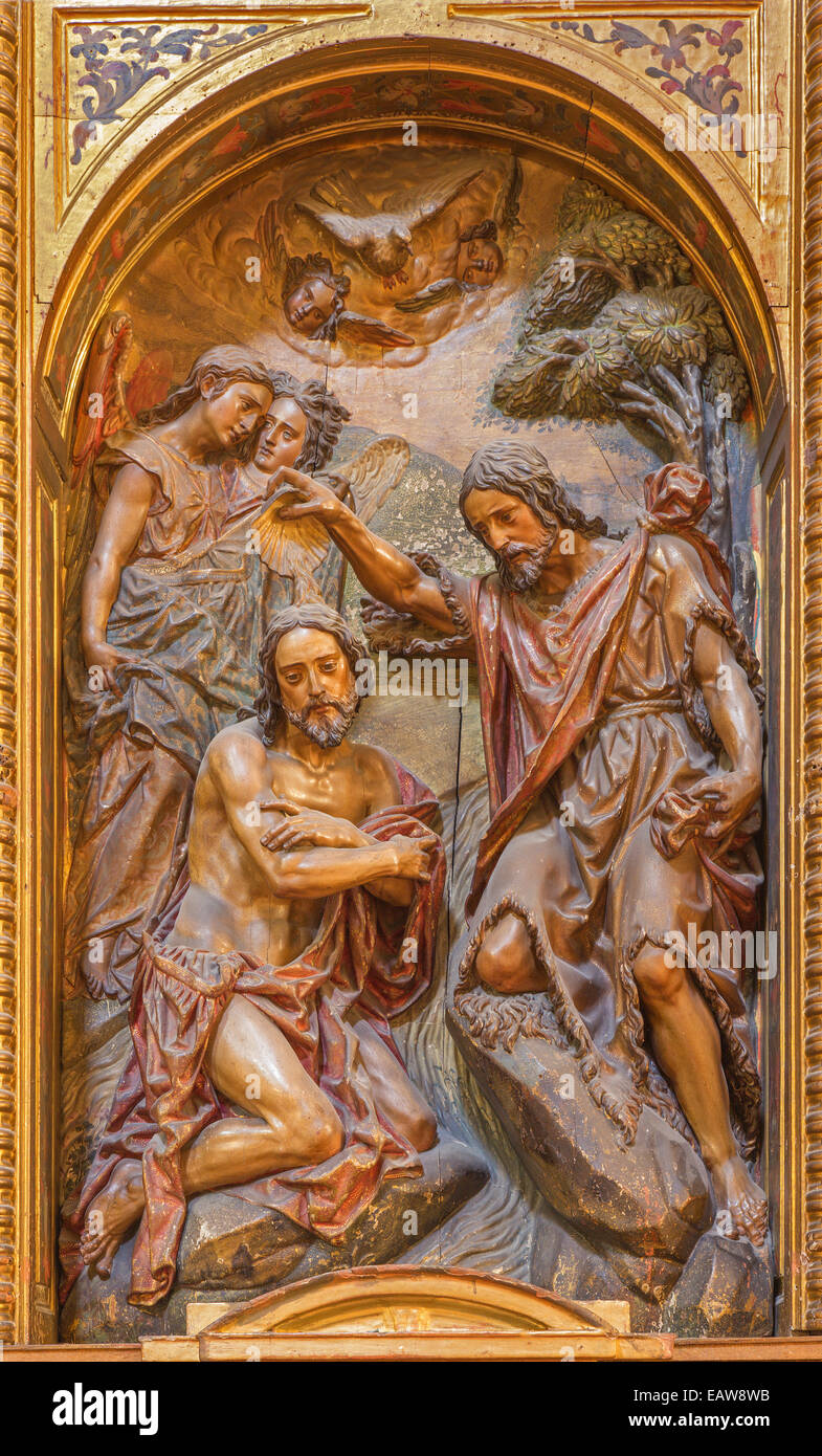Seville - The carved polychrome relief of the Baptism of Christ in church Iglesia de la Anunciacion - Stock Image