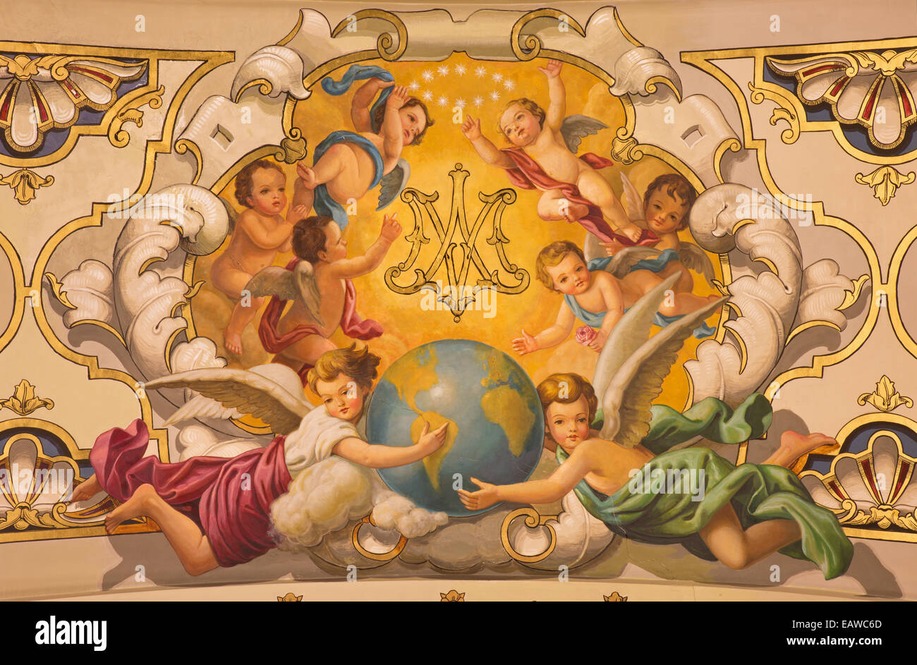 Seville - The fresco angels and the monogram of Virgin Mary on the ceiling in church Basilica de la Macarena - Stock Image