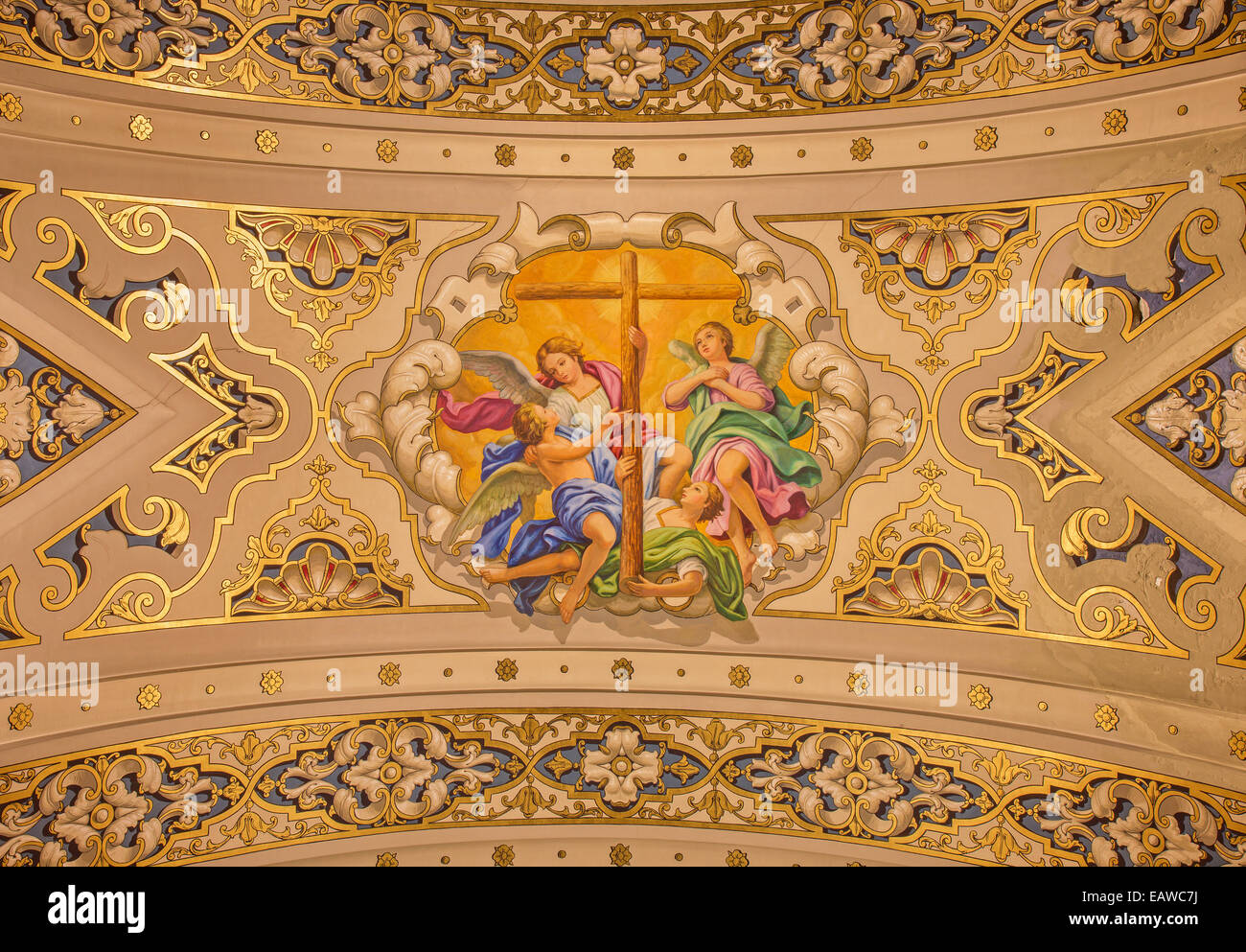 SEVILLE, SPAIN - OCTOBER 29, 2014: The fresco angels with the cross on the ceiling in church Basilica de la Macarena - Stock Image
