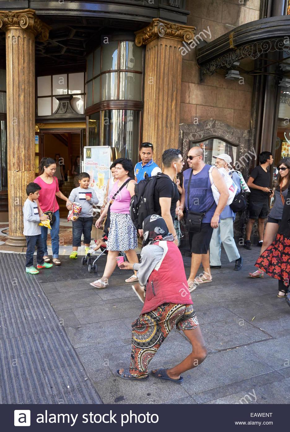 Deformed woman Beggar on Gran Via in Madrid in Spain - Stock Image