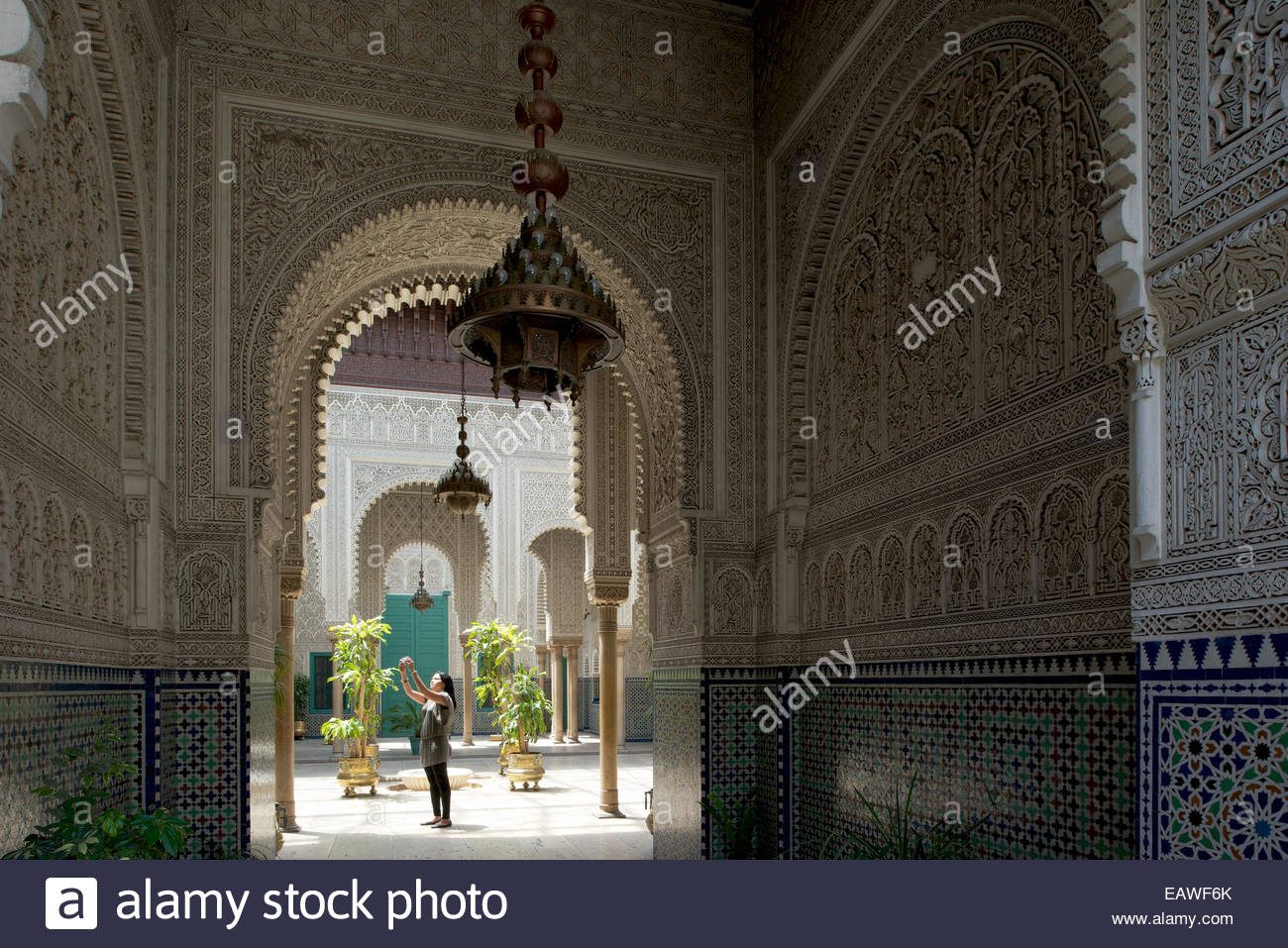 The richly decorated walls and arches of the Mahkama du Pacha. - Stock Image