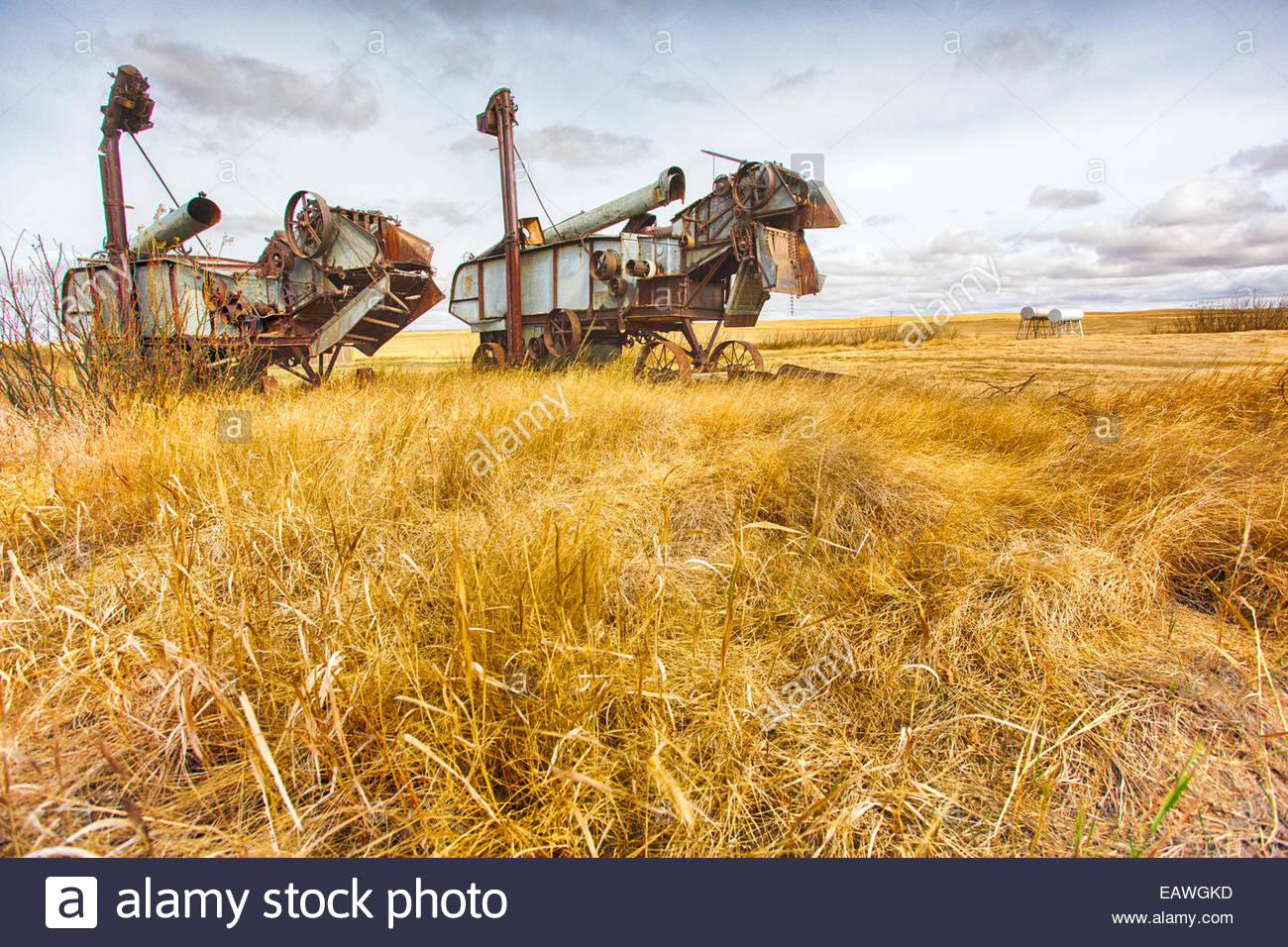 Two old-fashioned threshers on the Canadian prairie. - Stock Image