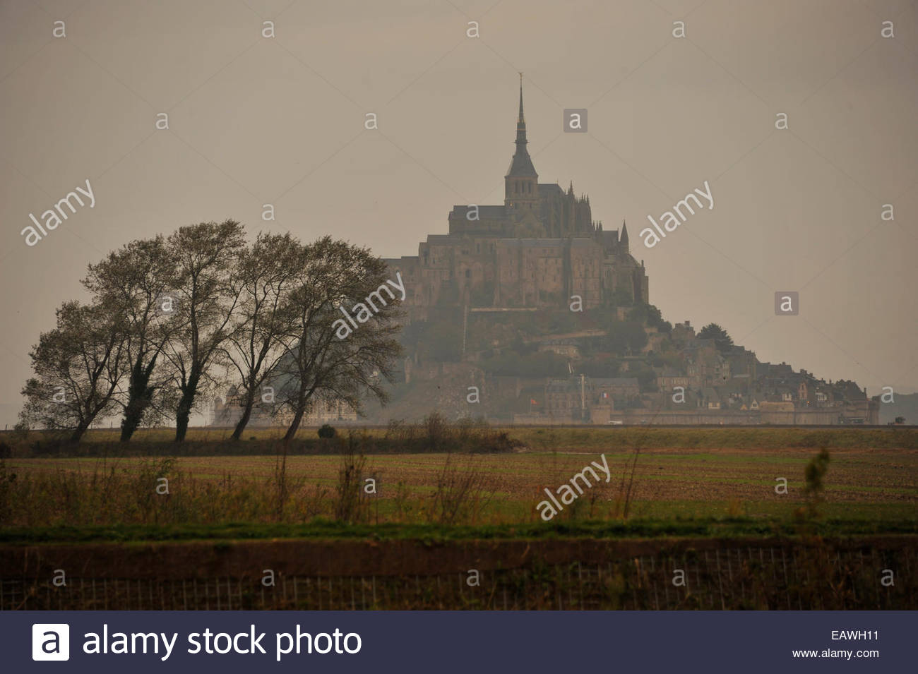 Misty, view of Mont St. Michel conveys a sense of mystery. - Stock Image