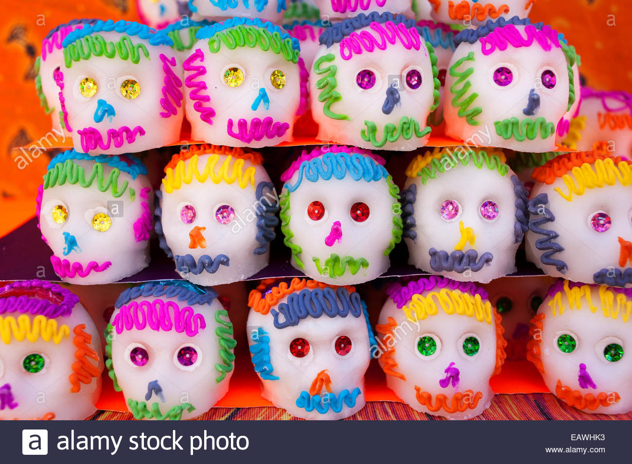 A display of sugar skulls celebrates Mexico's Day of the Dead. - Stock Image