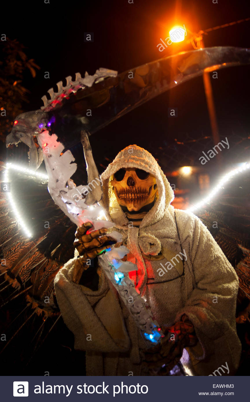 A celebrant dresses as The Grim Reaper for the Day of the Dead. - Stock Image