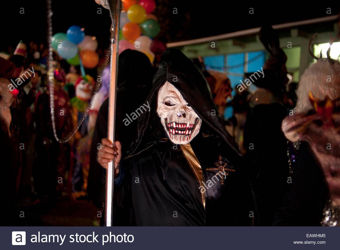 A celebrant dresses as The Grim Reaper for the Day of the Dead. Stock Photo