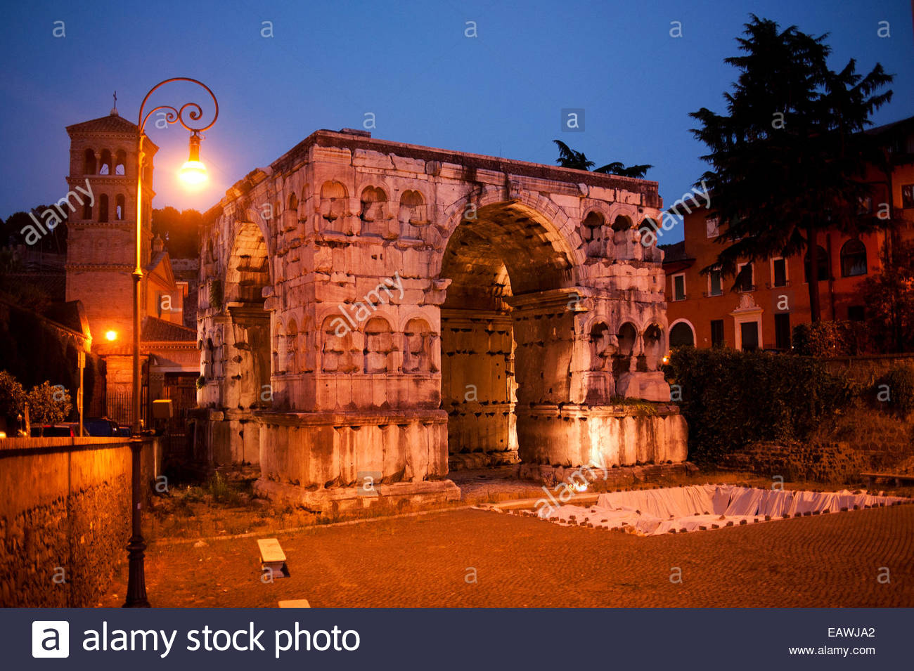 Lights illuminate the Arch of Janus in Rome. - Stock Image