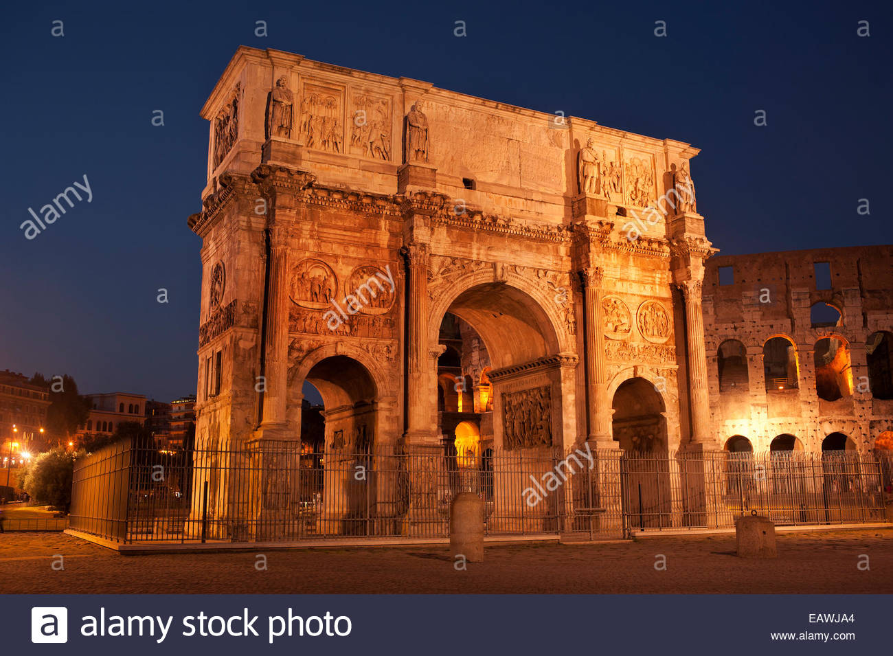 Lights illuminate the Arch of Constantine at night. - Stock Image