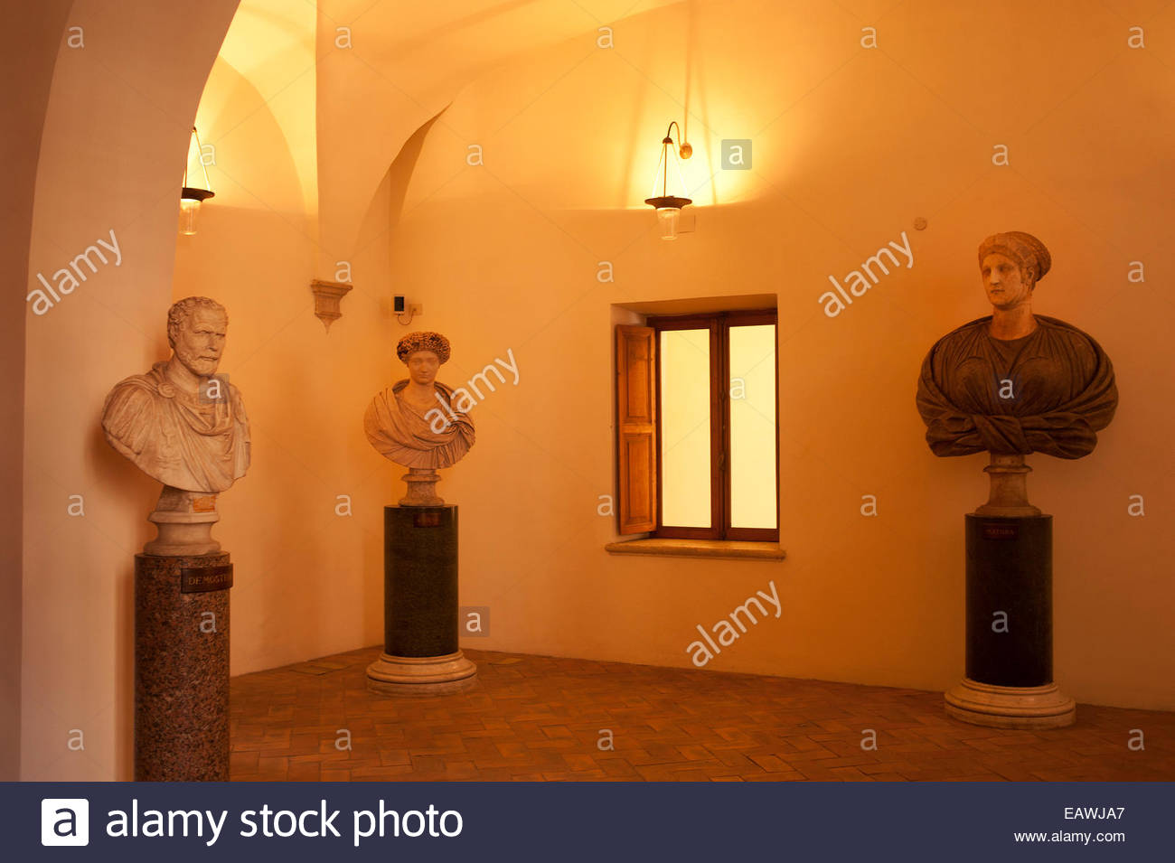 Portrait busts on display at the Palazzo Altemps in Rome. - Stock Image