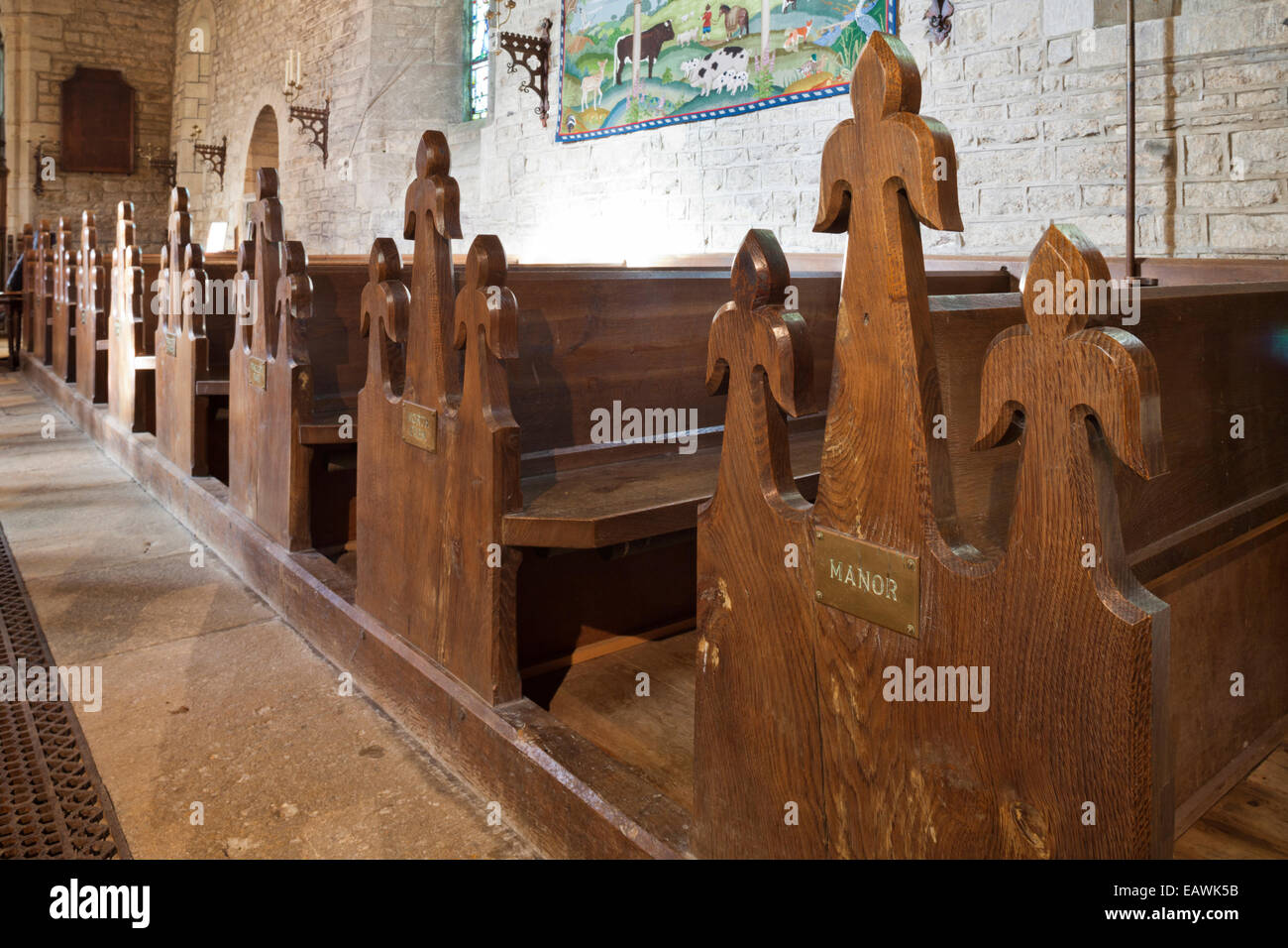 Pew bench ends labeled with local properties in St Marys church in the Cotswold village of Edgeworth, Gloucestershire - Stock Image
