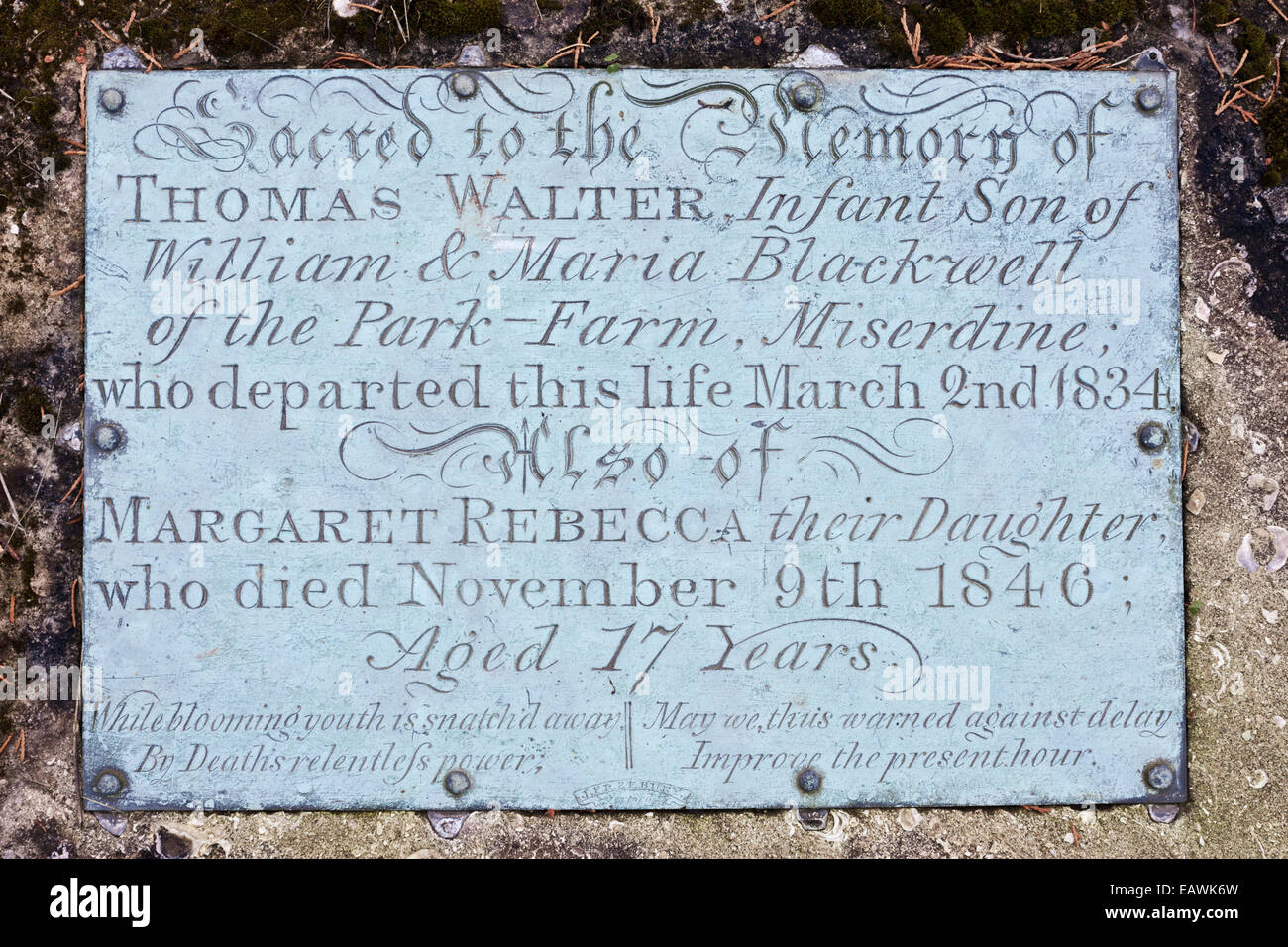 Brass plaque demonstrating infant mortality on a gravestone in the Cotswold village of Edgeworth, Gloucestershire - Stock Image