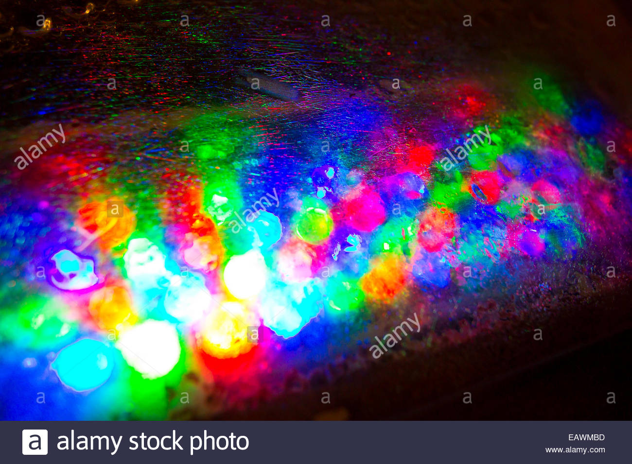 Colorful lights illuminate the side of the Seven Stars Resort. - Stock Image