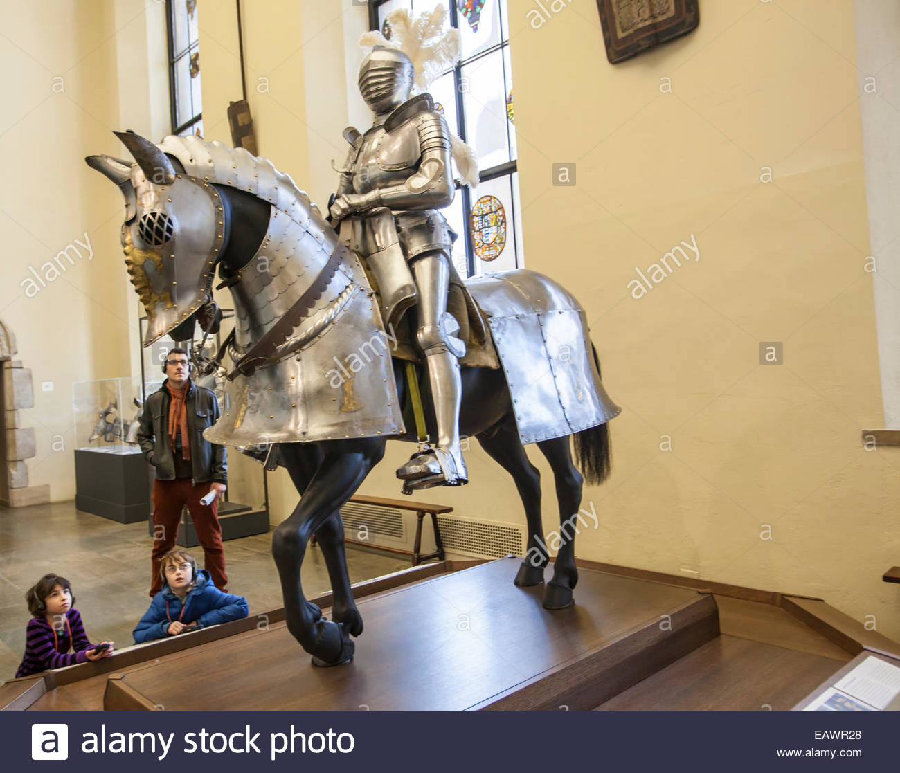 Children gaze up at an armored horse and knight on exhibit in the Philadelphia Museum of Art. - Stock Image