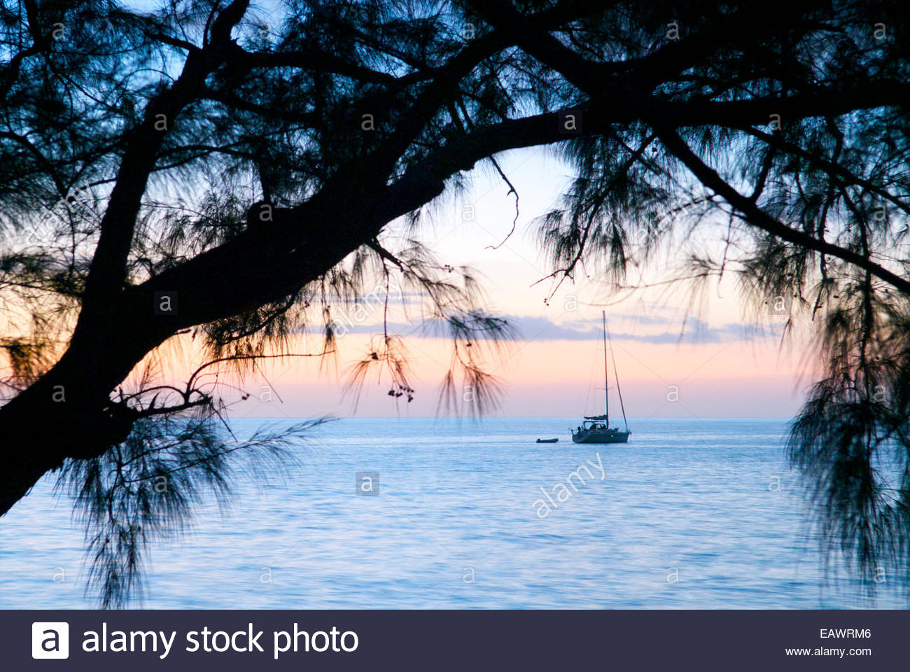 A yacht anchored in the calm waters of Pigeon Bay off Cat Island. Stock Photo