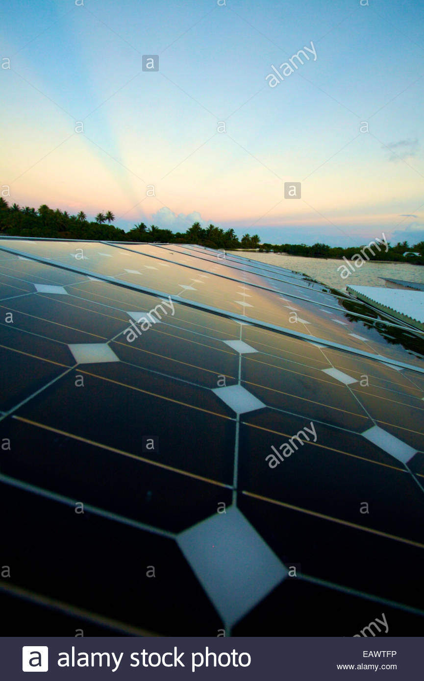 Solar panels cover the roof of an ecological, Tahitian black pearl farm in the  Tuamotus. - Stock Image
