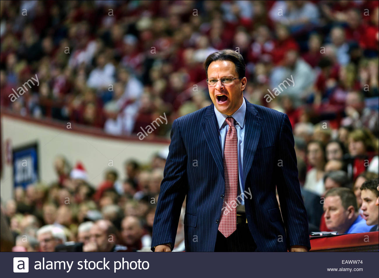 Indiana University head basketball coach Tom Crean shouts encouragement to players from the sidelines in Assembly - Stock Image