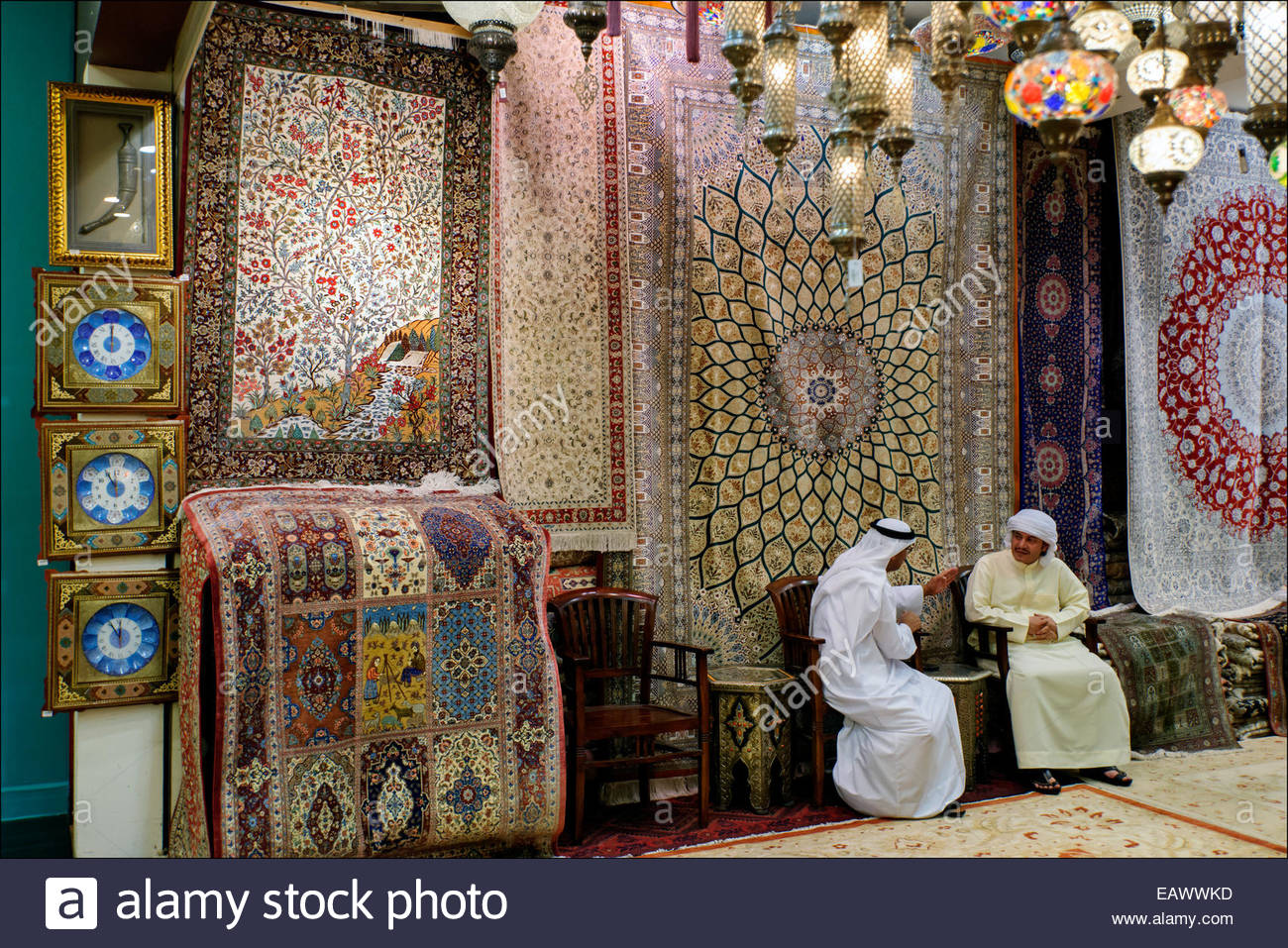 Arab merchants talk in a carpet store in the 2.4 million square foot Mall of the Emirates, opened in 2005 in what - Stock Image