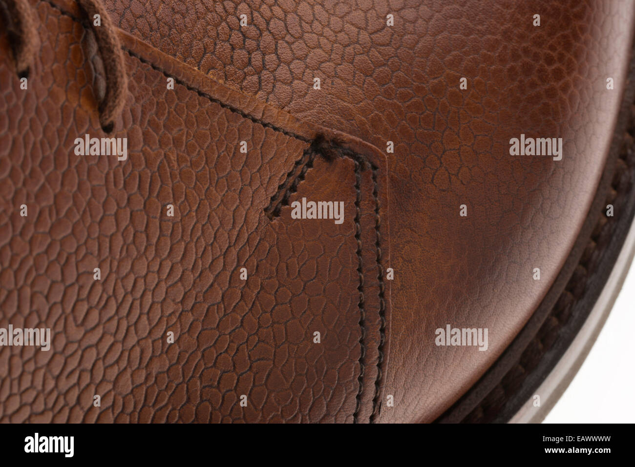 Side of rustic, textured shoe leather. Polished surface of English real brown leather, made in Northampton. - Stock Image