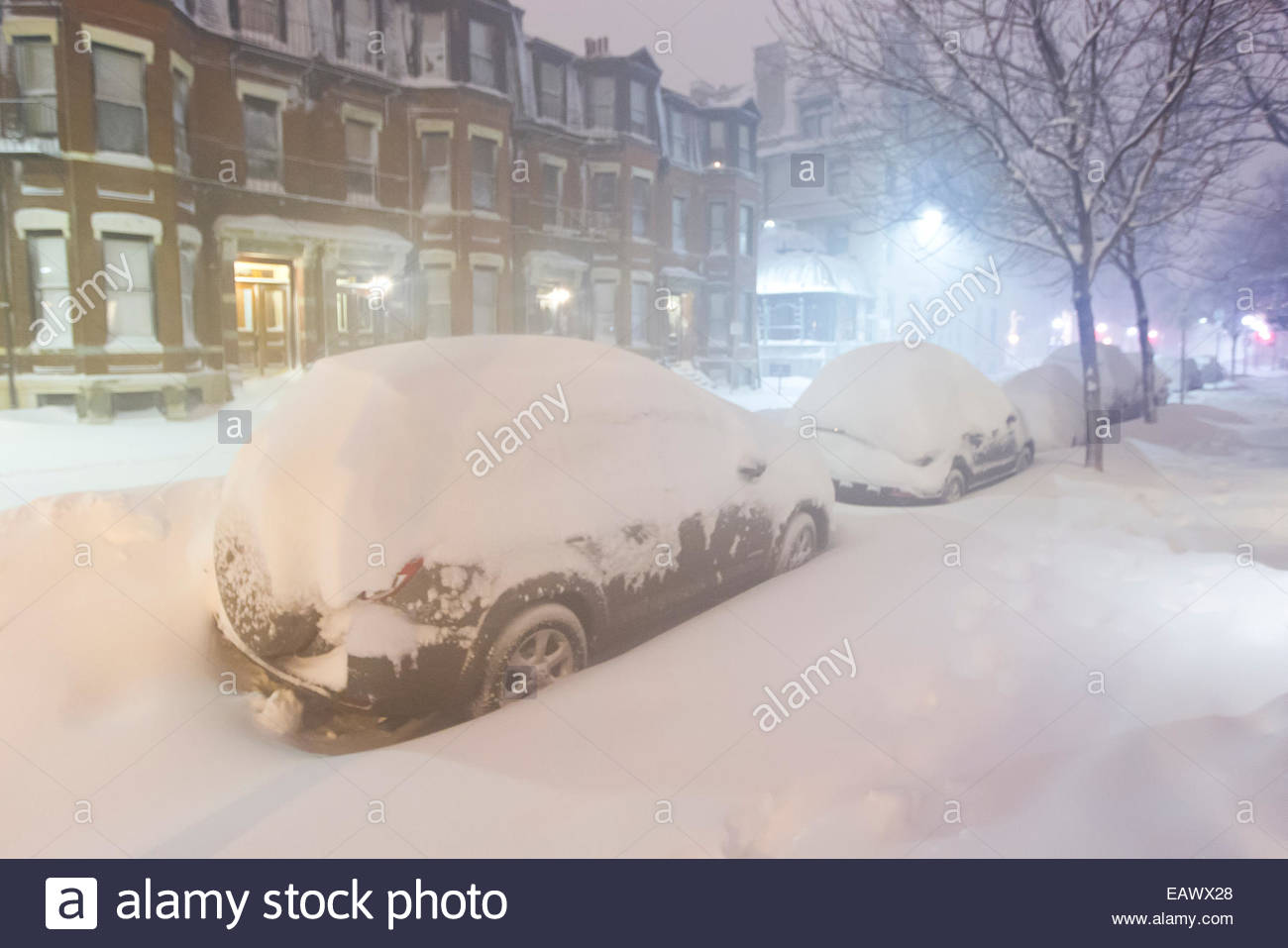 Mounds of snow bury parked vehicles during the historic blizzard that hit Boston in 2013. - Stock Image