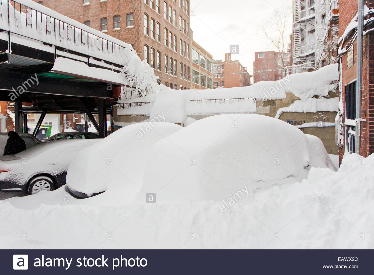 Snow completely buries vehicles after the historic blizzard that hit Boston in 2013. - Stock Image