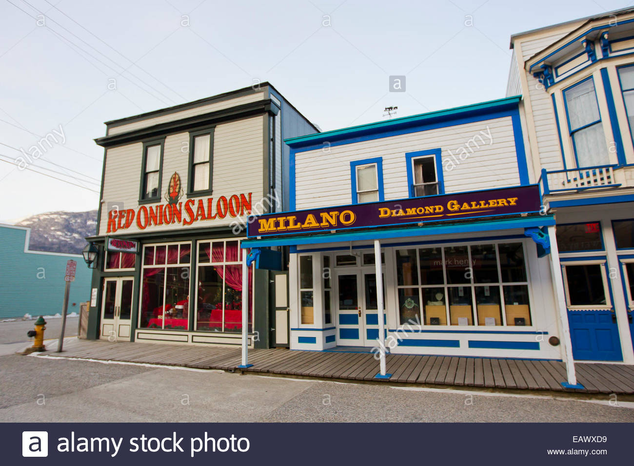 Gift shops and the Red Onion Saloon line a street in downtown Skagway. - Stock Image
