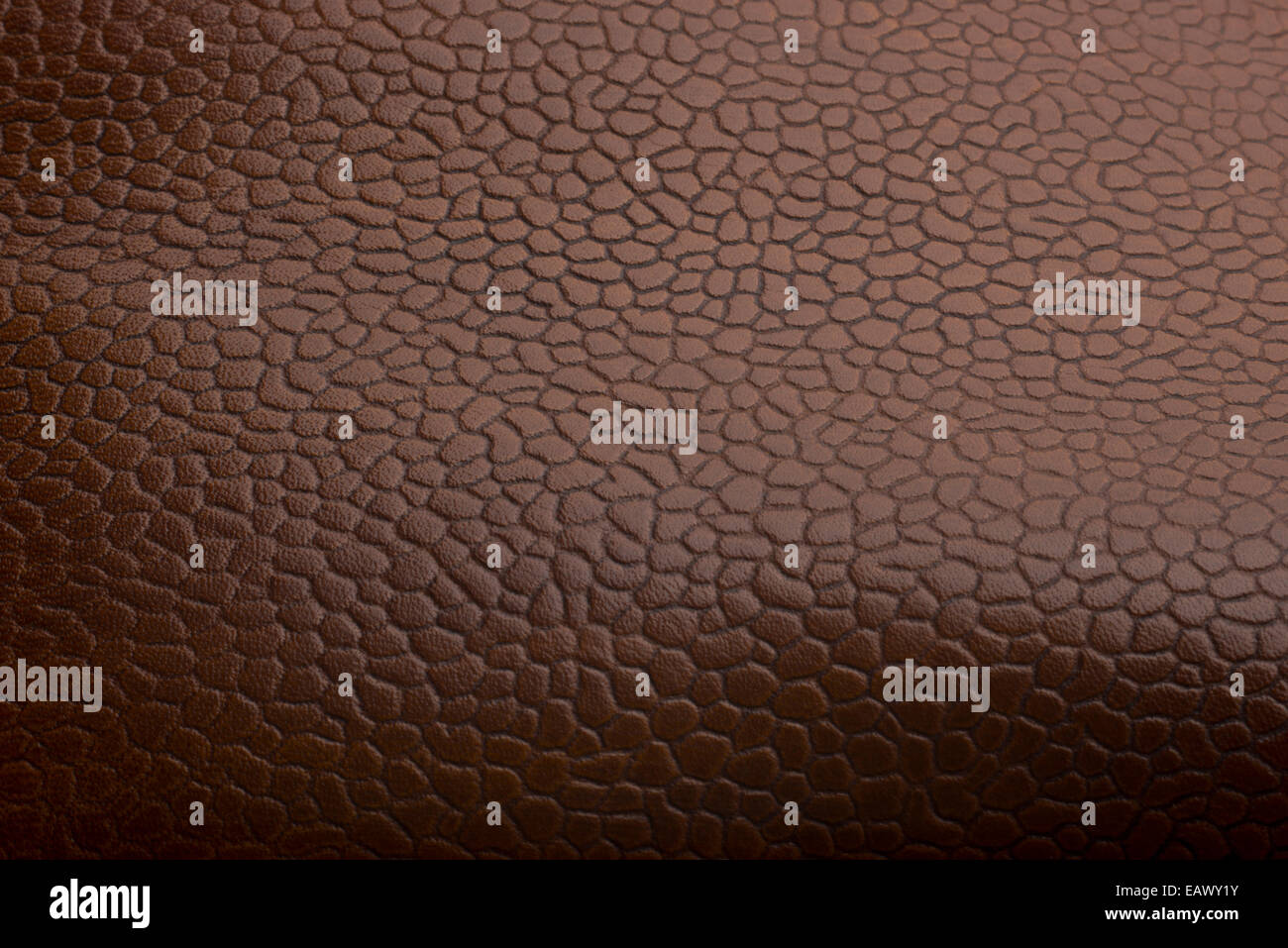 Rustic, textured shoe leather. Polished surface of English real brown leather, made in Northampton. - Stock Image