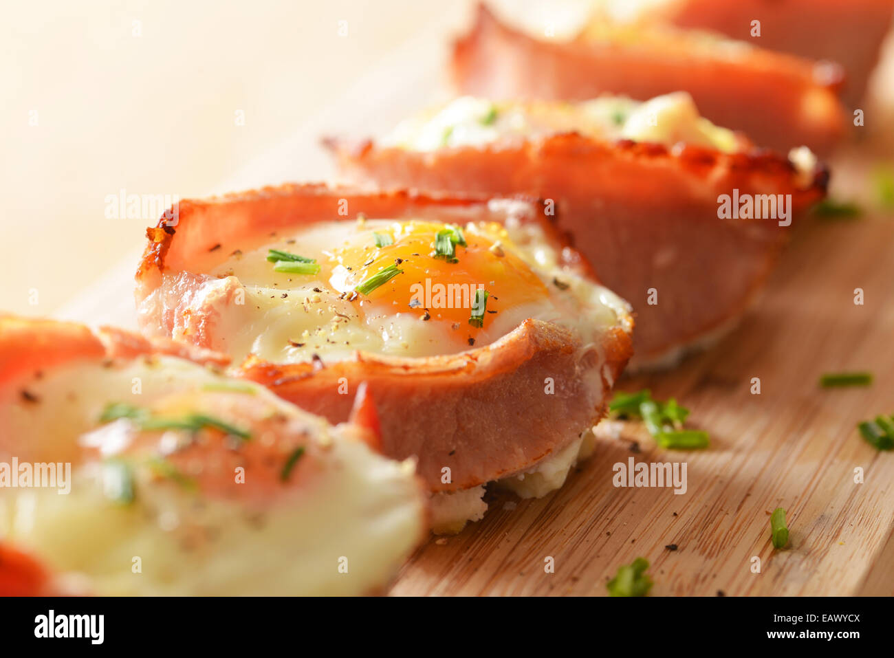 Egg and bacon cupcakes served and ready to eat. - Stock Image