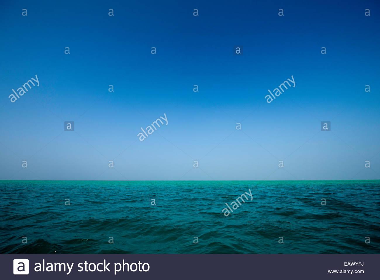 The horizon over water off Mabualau Island. - Stock Image