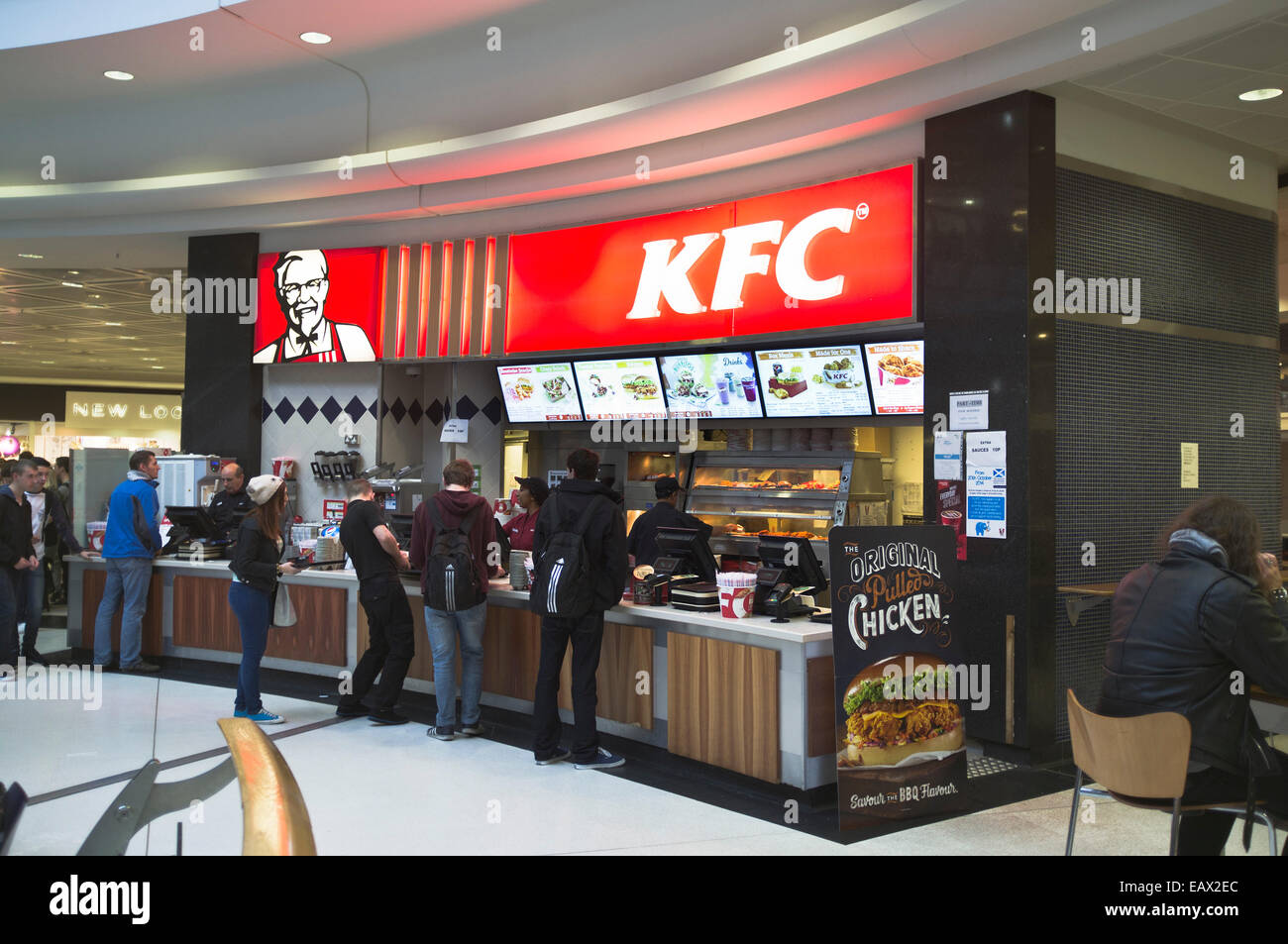 dh KFC FASTFOOD UK Kentucky Fried Chicken outlet Inverness people being served restaurant - Stock Image