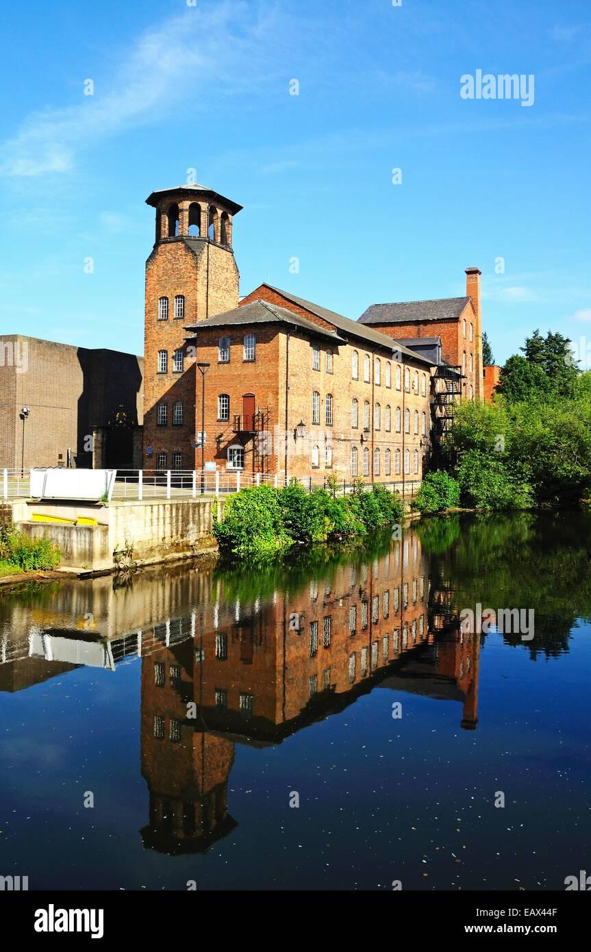 The Silk Mill alongside the River Derwent, Derby, Derbyshire, England, UK, Western Europe. - Stock Image