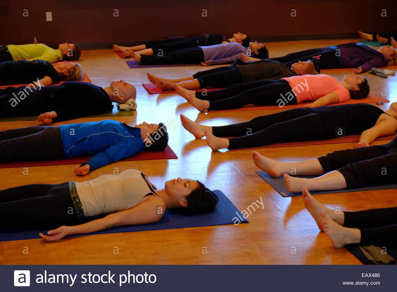yoga students in savasana or corpse pose stock photo 75562150 alamy