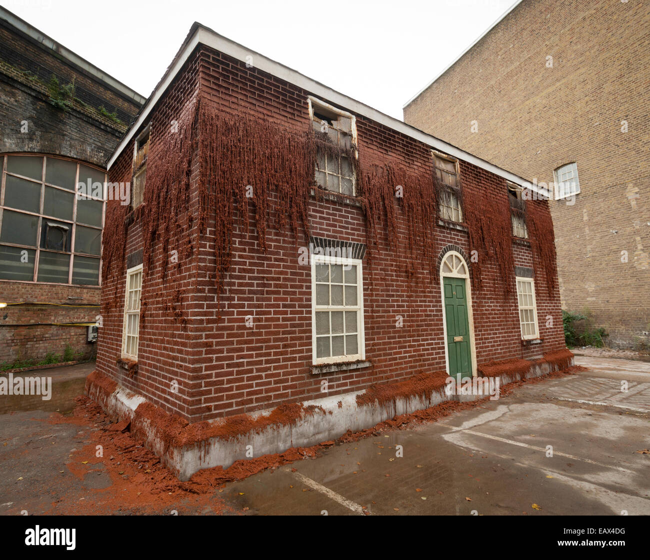 Melting House by Alex Chinneck 40 Southwark St London, SE1. Artwork made of wax and heated slowly to melt it over - Stock Image