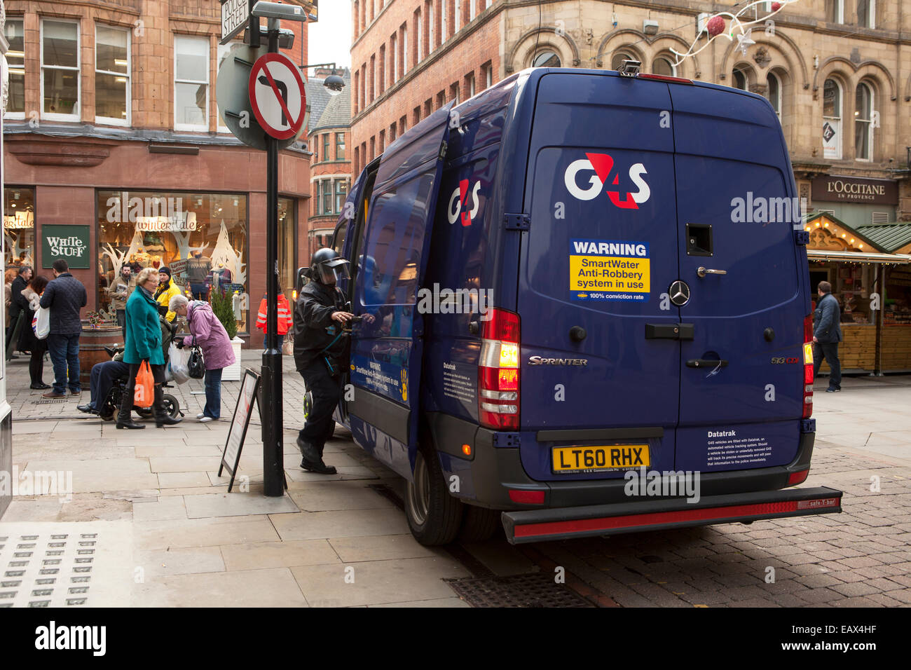 G4s Cash In Transit Van With Security Guard Entering