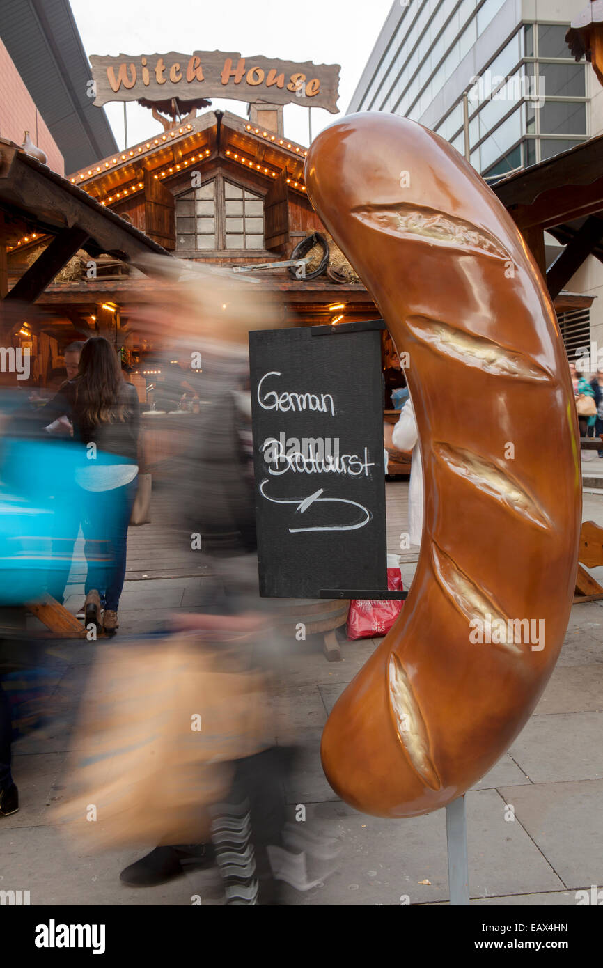 Witch House Large Oversize German Bratwurst with sign Christmas Markets and shoppers, Manchester, UK Stock Photo