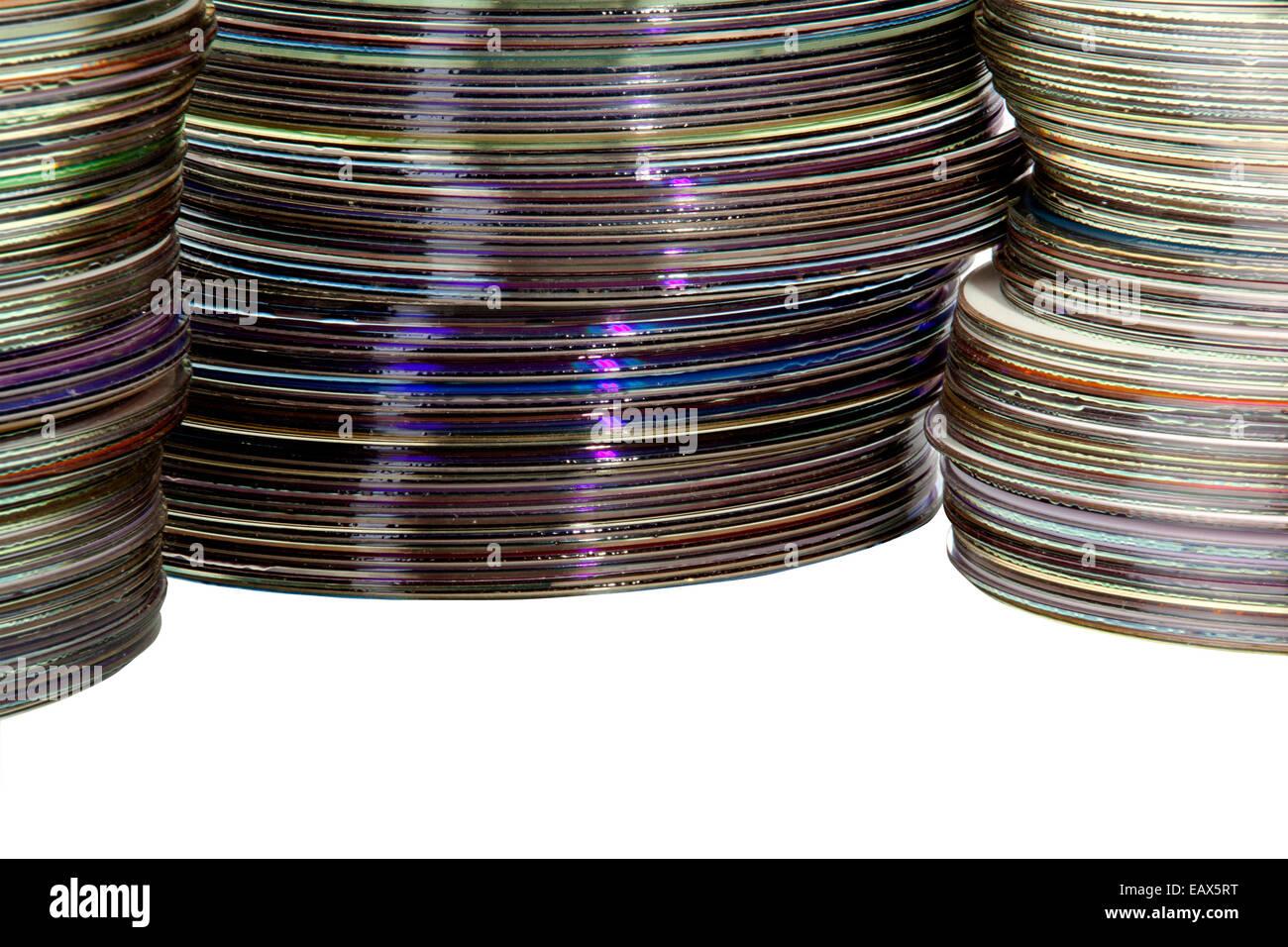 closeup three piles of colorful compact discs Stock Photo