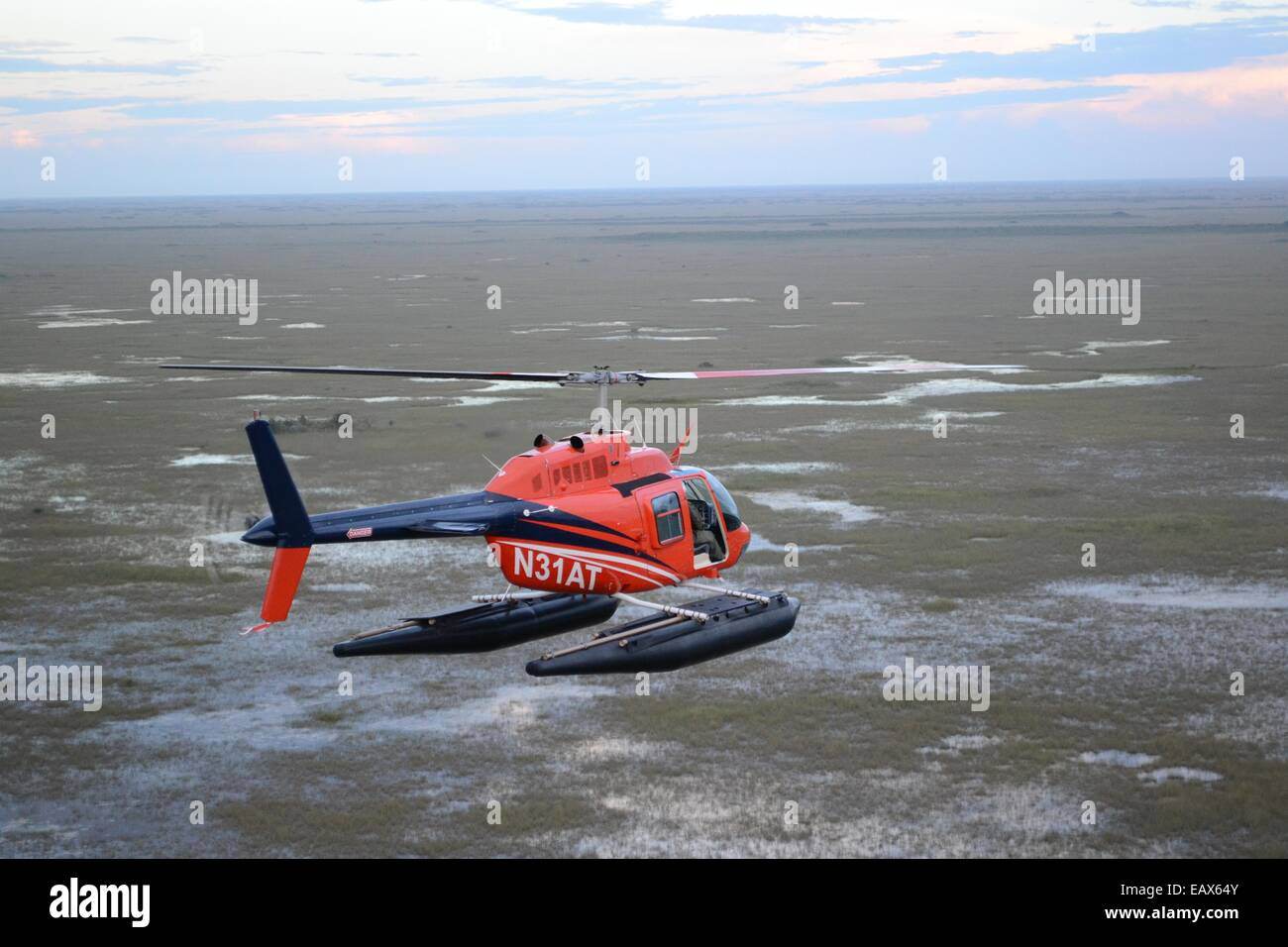 A research helicopter flies over the Everglades National Park during the Environmental Protection Agency Everglades Stock Photo