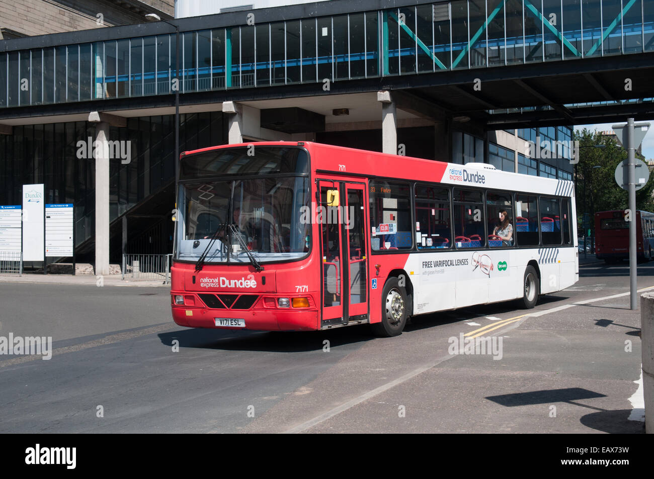 A National Express Dundee Volvo B10BLE with Wrightbus bodywork passes through the city. - Stock Image