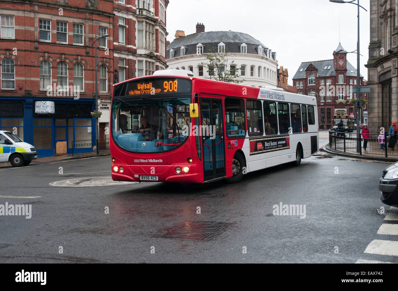 A National Express West Midlands Volvo B7RLE with Wrightbus bodywork passes through the center of Wolverhampton - Stock Image